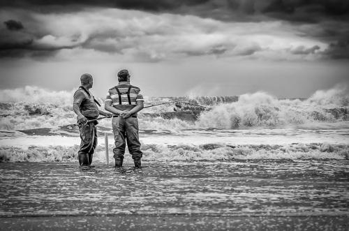 South Africa Hermanus Two Fisherman Fishing in the Ocean