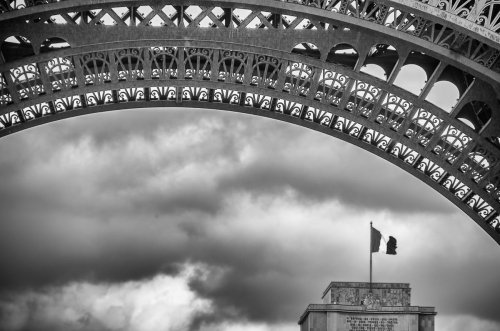 France Paris Arch of Eiffel Tower with Flag