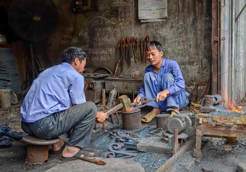 Vietnam Saigon Two Blacksmith at Work
